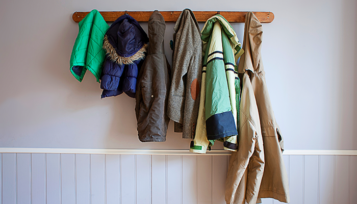 Coat rack with different types of coats on it
